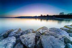 Nascer do sol no lago Genebra em Genebra, Suíça Imagem de Stock