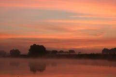 Nascer do sol no rio Imagem de Stock