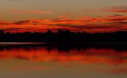 Nascer do sol refletido Imagens de Stock