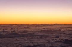 Nascer do sol sobre as nuvens Imagem de Stock Royalty Free