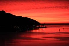 Nascer do sol sobre Lyttelton e porto Fotos de Stock Royalty Free