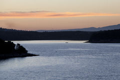 Nascer do sol sobre o mar Fotografia de Stock Royalty Free