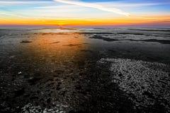 Nascer do sol sobre o mar gelado Imagem de Stock Royalty Free
