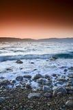 Nascer do sol sobre o mar inoperante fotos de stock