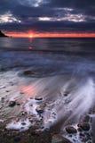 Nascer do sol sobre o oceano Foto de Stock Royalty Free