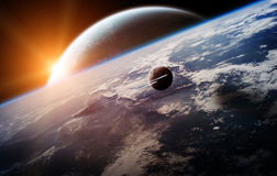 Nascer do sol sobre o sistema distante do planeta no elemento da rendição do espaço 3D Imagem de Stock