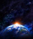 Nascer do sol sobre a terra Imagens de Stock Royalty Free