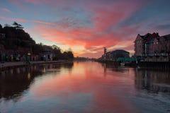 Nascer do sol vermelho no cais de Exeter Fotos de Stock Royalty Free