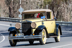 1929 Nash Advanced 6 Cabriolet driving on country road Stock Photography