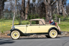1929 Nash Advanced 6 Cabriolet driving on country road Royalty Free Stock Photography