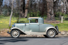 1929 Nash Coupe driving on country road Stock Image