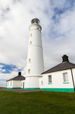 Nash Point East Tower Lighthouse. White lighthouse and associated buildings. Nash Point, Vale of Glamorgan, Wales Royalty Free Stock Images