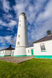 Nash Point East Tower Lighthouse. White lighthouse and associated buildings. Nash Point, Vale of Glamorgan, Wales Royalty Free Stock Photography