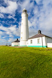 Nash Point East Tower Lighthouse. White lighthouse and associated buildings. Nash Point, Vale of Glamorgan, Wales Royalty Free Stock Photos