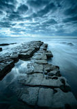 Nash Point. A protruding rock shelf at Nash Point, on the Glamorgan Coast, Wales Stock Images