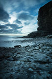 Nash Point at Sunset. Rocks on the coast next to the cliff face at Nash Point, Glamorgan coast, Wales Royalty Free Stock Images