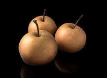 Nashi japanese pears on dark board with reflections Royalty Free Stock Photography