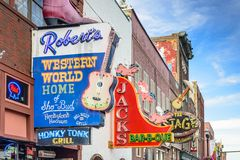 Nashville Honkey Tonk Bars. NASHVILLE, TENNESSEE - JUNE 14, 2013: Honky-tonks on Lower Broadway. The district is famous for the numerous country music Stock Photography