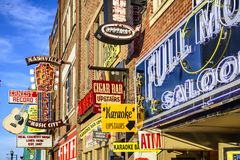 Nashville Honkey Tonk Bars. NASHVILLE, TENNESSEE - JUNE 14, 2013: Honky-tonks on Lower Broadway. The district is famous for the numerous country music Stock Photo
