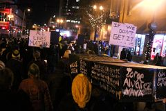 Nashville - Police Brutality Protest carry coffins. Coffins at an Eric Garner vigil in Nashville, these were carried by protesters against police brutality and Royalty Free Stock Images