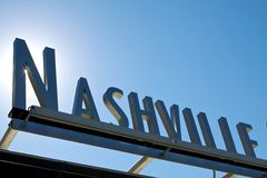 Nashville sign 3D angle sun. Nashville sign at angle below the blue sky and sunlight