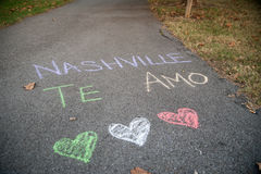 Nashville Te Amo. `Nashville Te Amo` written on the pavement at Coleman Park on Thompson Lane in Nashville, with three hearts in the colors of the Mexican Flag Stock Photography