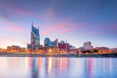 Nashville, Tennessee downtown skyline with Cumberland River in USA. At sunset royalty free stock photography