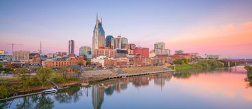 Nashville, Tennessee downtown skyline with Cumberland River in USA. At sunset stock photo