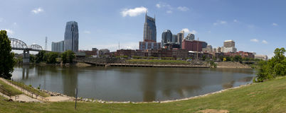 Nashville , Tennessee (panoramic). 180 degree panoramic view of the downtown skyline of Nashville Tennessee with the Cumberland River in the fore ground Stock Images