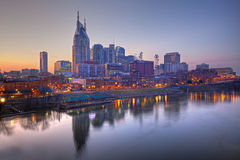 Nashville, Tennessee skyline. Skyline of Nashville, Tennessee at sunset showing reflections in the Cumberland River Royalty Free Stock Photo