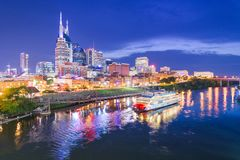 Nashville, Tennessee, USA. Skyline and riverboat on the Cumberland River at night stock photos