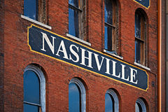 Nashville. The word Nashville painted on a side of red brick building in Nashville, Tennessee