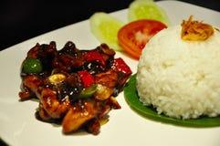 Nasi Ayam Lada Hitam arkivbild