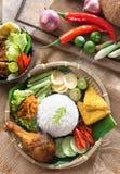 Nasi ayam penyet. Popular Indonesian local food nasi ayam penyet, indonesian fried chicken rice with sambal belacan. Fresh hot with steam smoke royalty free stock image