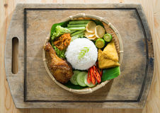 Nasi ayam penyet. Delicious nasi ayam penyet with sambal belacan. Fried chicken rice with overhead view. Famous traditional Indonesian food royalty free stock image