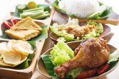Nasi ayam penyet. Famous traditional Indonesian food. Delicious nasi ayam penyet with sambal belacan. Fresh hot with steam smoke royalty free stock photos