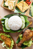 Nasi ayam penyet. Famous traditional Indonesian food. Delicious nasi ayam penyet with sambal belacan. Fried chicken rice and tea with overhead view stock photos