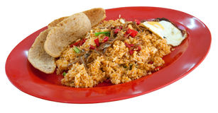 Nasi Goreng. Malay style spicy fried rice with egg and crackers Royalty Free Stock Photo