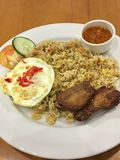 Nasi goreng. Asian fried rice with egg and spicy sambal on white Stock Photography