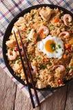 Nasi goreng with chicken, shrimp and vegetables closeup vertica Stock Photography