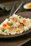 Nasi goreng with pork stripes. On plate Royalty Free Stock Photo