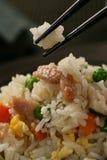 Nasi goreng with pork stripes and chopsticks Royalty Free Stock Photo