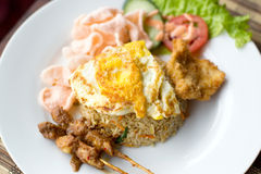 Nasi Goreng with prawn crackers and chicken satay Stock Photo