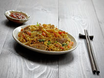 Nasi goreng with sambal, fried rice with chili paste. Delicious Indonesian fried rice with vegetables and pork. Served with a hot chili paste Stock Photo