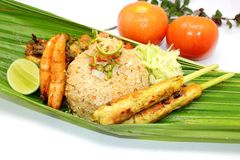 Nasi Goreng Satay Lilit. Accompanied with fried prawn,salad and Chicken Rendang Stock Photo