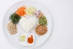 Nasi kerabu or kao yum, Southen Thai-Style rice. With herbs and vegetables on white paper background Royalty Free Stock Image
