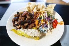Nasi kerabu or nasi ulam, popular Malay rice dish. Blue color of rice resulting from the petals of butterfly-pea flowers. Traditio. Nal Malaysian food, Asian royalty free stock photography