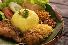 Nasi Kuning Gula ris för indones royaltyfri foto