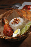 Nasi Lemak. With fried chicken drumstic Royalty Free Stock Photography