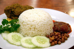 Nasi Lemak. Rice boiled in coconut milk, accompanied by curry and sambal Royalty Free Stock Images